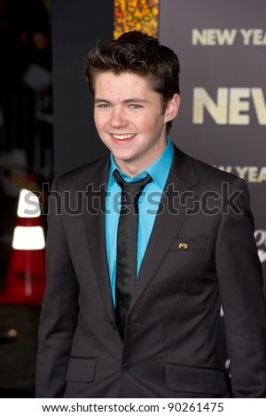 "HOLLYWOOD, CA - DECEMBER 5: Actor Damian McGinty arrives at the premiere of ""New Year's Eve"" at Grauman's Chinese Theater on December 5, 2011 in Hollywood, California"