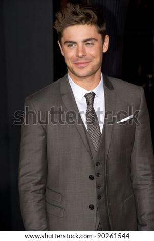 "HOLLYWOOD, CA - DECEMBER 5: Actor Zac Efron arrives at the premiere of ""New Year's Eve"" at Grauman's Chinese Theater on December 5, 2011 in Hollywood, California - stock photo"