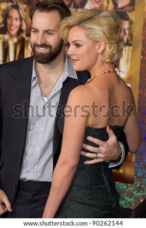 "HOLLYWOOD, CA - DECEMBER 5: Actress Katherine Heigl and her husband Josh Kelley arrive at the premiere of ""New Year's Eve"" at Grauman's Chinese Theater on December 5, 2011 in Hollywood, California"