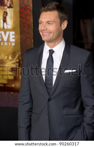 """HOLLYWOOD, CA - DECEMBER 5: Ryan Seacrest arrives at the premiere of """"New Year's Eve"""" at Grauman's Chinese Theater on December 5, 2011 in Hollywood, California - stock photo"""