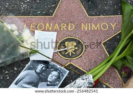 HOLLYWOOD, CA � FEBRUARY 27, 2015: Leonard Nimoy's star on the Hollywood Walk of Fame is surrounded by flowers and various memorial tributes left by fans on February 27 2015. - stock photo