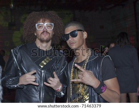 HOLLYWOOD, CA - FEBRUARY 11: Music group LMFAO attend the 14th annual 'Friends 'N' Family' GRAMMY party at Paramount Studios on February 11, 2011 in Hollywood, California