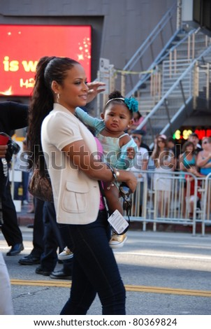 "HOLLYWOOD, CA- JUNE 18: Actress/singer Christina Milian and daughter attend the Disney's Pixar ""Cars 2"" premiere, held at El Capitan Theatre, June 18, 2011 in Hollywood,CA. - stock photo"