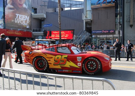 "HOLLYWOOD, CA- JUNE 18: Character Lightning McQueen arrives at Disney's Pixar ""Cars 2"" premiere, held at El Capitan Theatre, June 18, 2011 in Hollywood,CA. - stock photo"