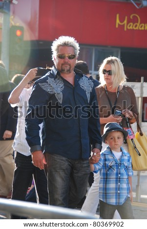 "HOLLYWOOD, CA- JUNE 18: Chef Guy Fieri (C) and family attend the Disney's Pixar ""Cars 2"" premiere, held at El Capitan Theatre, June 18, 2011 in Hollywood,CA. - stock photo"