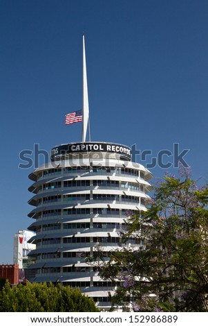 HOLLYWOOD, CA - JUNE 20: The Capitol Records building on Vine St. in Hollywood June, 20 2013 in Hollywood, California. The red light atop the building�s tower spells out �Hollywood� in Morse code. - stock photo
