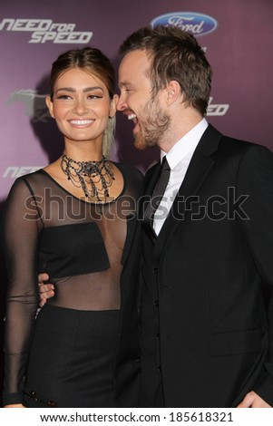"HOLLYWOOD, CA - MARCH 07: Lauren Parsekian and Aaron Paul attend Premiere Of DreamWorks Pictures' ""Need For Speed"" - Red Carpet. Mar 07 2014 - TCL Chinese Theatre - Hollywood, California United States - stock photo"