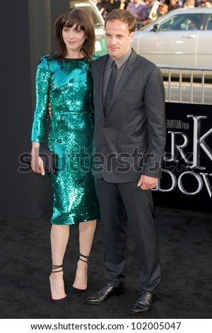 HOLLYWOOD, CA - MAY 7: Actor Jonny Lee Miller and wife Michele Hicks arrive at the premiere of the Warner Bros. Pictures Dark Shadows on May 7, 2012 in Hollywood, California.