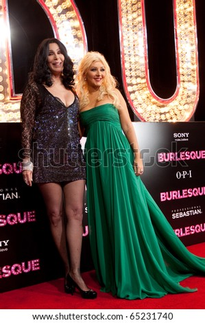 HOLLYWOOD, CA - NOVEMBER 15: Actress and singer Cher and Christina Aguilera arrive to the premiere of the movie Burlesque at the Grauman's Chinese Theater, on November 15, 2010 in Los Angeles, CA - stock photo