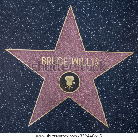 HOLLYWOOD,CA - OCTOBER 8, 2015: Bruce Willis star on Hollywood Walk of Fame in Hollywood, California. This star is located on Hollywood Blvd. and is one of 2400 celebrity stars. - stock photo