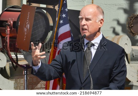 HOLLYWOOD, CA - SEPTEMBER 18, 2014: California Governor Jerry Brown gestures as he speaks at the signing of the California Film and Television Job Retention Act in Hollywood, CA on September 18, 2014.