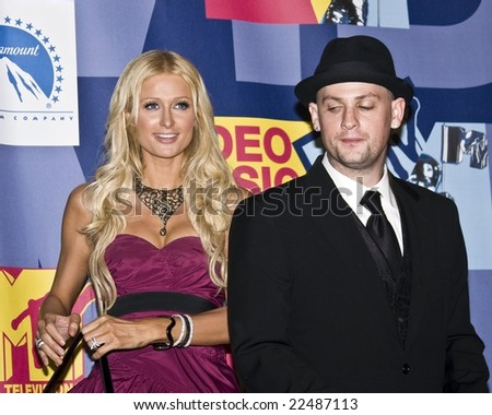 HOLLYWOOD, CA - SEPTEMBER 7:  Socialite Paris Hilton and Musician Benji Madden pose together in the press room at the 2008 MTV Video Music Awards at Paramount Pictures Studio in Hollywood, California. - stock photo