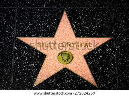 HOLLYWOOD, CA/USA - APRIL 18, 2015: Billy Crystal star on the Hollywood Walk of Fame. The Hollywood Walk of Fame is made up of brass stars embedded in the sidewalks on Hollywood Blvd. - stock photo