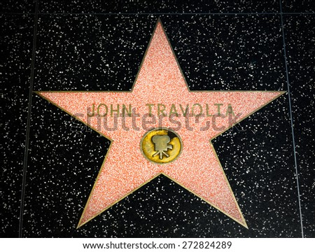 HOLLYWOOD, CA/USA - APRIL 18, 2015: John Travolta star on the Hollywood Walk of Fame. The Hollywood Walk of Fame is made up of brass stars embedded in the sidewalks on Hollywood Blvd. - stock photo
