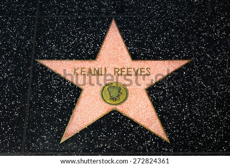 HOLLYWOOD, CA/USA - APRIL 18, 2015: Keanu Reeves star on the Hollywood Walk of Fame. The Hollywood Walk of Fame is made up of  brass stars embedded in the sidewalks on Hollywood Blvd. - stock photo