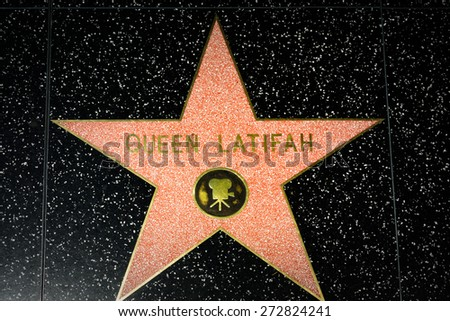 HOLLYWOOD, CA/USA - APRIL 18, 2015: Queen Latifah star on the Hollywood Walk of Fame. The Hollywood Walk of Fame is made up of brass stars embedded in the sidewalks on Hollywood Blvd. - stock photo