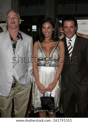 "HOLLYWOOD, CALIFORNIA. April 17, 2006. Bill Murray, Ines Sastre and Andy Garcia attend the Los Angeles Premiere of ""The Lost City"" held at the Arclight Cinemas in Hollywood, California United States. - stock photo"