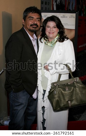 """HOLLYWOOD, CALIFORNIA. April 17, 2006. George Lopez attends the Los Angeles Premiere of """"The Lost City"""" held at the Arclight Cinemas in Hollywood, California United States.  - stock photo"""