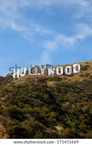 HOLLYWOOD CALIFORNIA - APRIL 12, 2013: Located in Hollywood Hills at Mount Lee is the world famous landmark Hollywood Sign in Los Angeles, California on April 12, 2013. Some antennas digital deleted. - stock photo