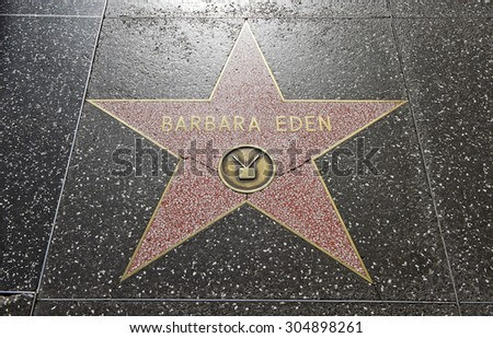 "HOLLYWOOD - CALIFORNIA, AUG. 15, 2014: Terrazzo & Brass embedded in the sidewalk on ""Hollywood Walk of Fame"" honoring actress Barbara Eden on Hollywood Boulevard in Hollywood, California USA - stock photo"