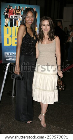 """HOLLYWOOD, CALIFORNIA. August 23, 2005. Zoe Saldana and Lacey Chabert at the World Premiere of """"Dirty Deeds"""" at the Directors Guild of America in Hollywood, California , United States. - stock photo"""