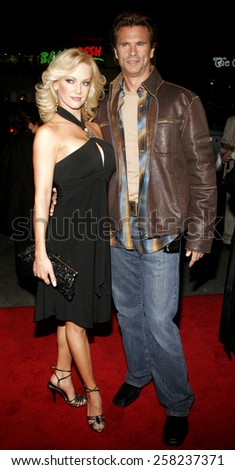 """HOLLYWOOD, CALIFORNIA. February 2, 2006. Lorenzo Lamas and Barbara Moore attend the World Premiere of """"Firewall"""" held at the Grauman's Chinese Theatre in Hollywood, California United States.  - stock photo"""