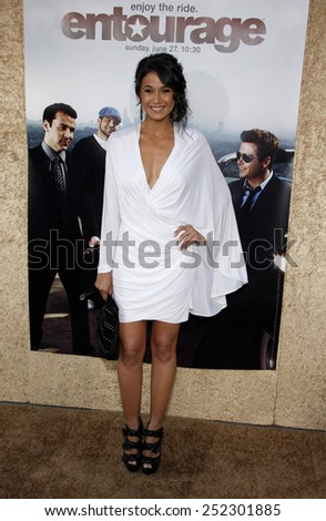"""HOLLYWOOD, CALIFORNIA - June 16, 2010. Emmannuelle Chriqui at the Season 7 premiere of """"Entourage"""" held at the Paramount Pictures Studios, Hollywood.  - stock photo"""