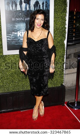 HOLLYWOOD, CALIFORNIA - March 26, 2012. Claudia Ferri at the Los Angeles Season 2 premiere of AMC's 'The Killing' held at the ArcLight Cinemas in Hollywood. - stock photo