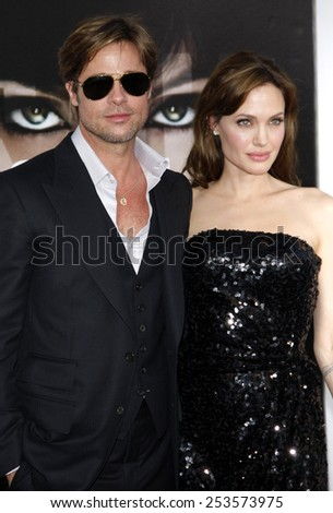 """HOLLYWOOD, CALIFORNIA - Monday July 19, 2010. Brad Pitt and Angelina Jolie at the Los Angeles premiere of """"Salt"""" held at the Grauman's Chinese Theater, Los Angeles.  - stock photo"""