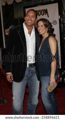 "HOLLYWOOD, CALIFORNIA. October 17, 2005. Dwayne Johnson and wife Dana at the Los Angeles Premiere of ""Doom""  at the Universal City Cinemas in Universal City, California United States."