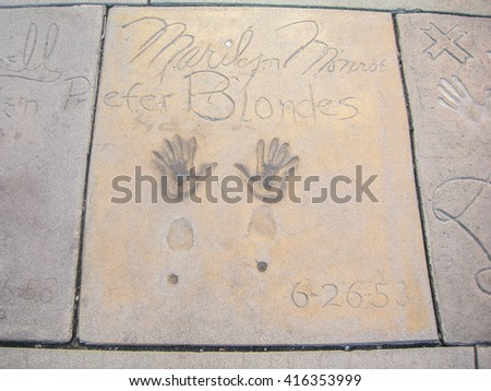 HOLLYWOOD, CALIFORNIA - OCTOBER 16, 2008 - famous prints of actress Marilyn Monroe in the walk of fame road of the most famous stars in the world - stock photo