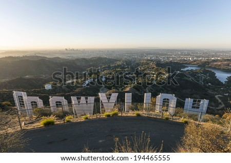 HOLLYWOOD, CALIFORNIA - October, 31:  Sunrise city view from hilltop behind the famous Hollywood sign in Griffith Park, on October 31, 2013 in Los Angeles, California. - stock photo