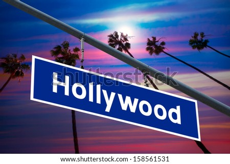Hollywood California road sign on redlight with pam trees sky photo mount - stock photo