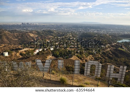 HOLLYWOOD CALIFORNIA - SEPTEMBER 29:  Hugh Hefner donates money to purchase and protect 138 acres behind the sign from development, on September 29, 2010 in Los Angeles, California. - stock photo