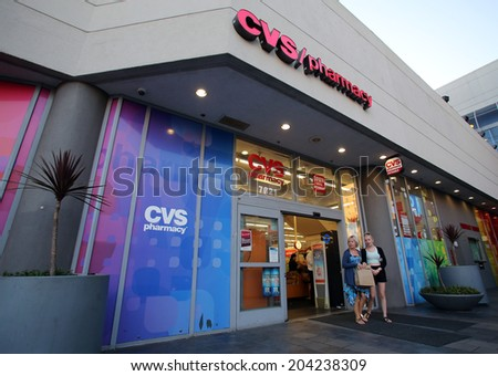 HOLLYWOOD, CALIFORNIA - TUES. JUNE 24, 2014: Pedestrians walk past a CVS drug store in Hollywood, California, on Sunday, June 29, 2014. CVS is the retail division of CVS Caremark - stock photo