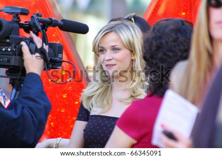 HOLLYWOOD - DECEMBER 1: Actress Reese Witherspoon giving interviews after  receiving her star on the Hollywood Walk of Fame December 1, 2010 in Hollywood, CA. - stock photo