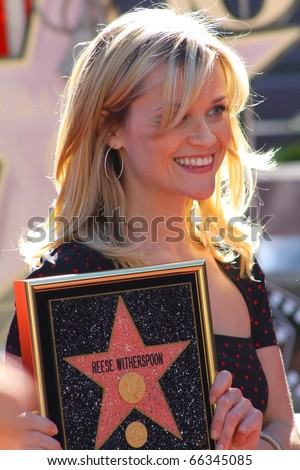 HOLLYWOOD - DECEMBER 1: Actress Reese Witherspoon receiving her star on the Hollywood Walk of Fame December 1, 2010 in Hollywood, CA. - stock photo