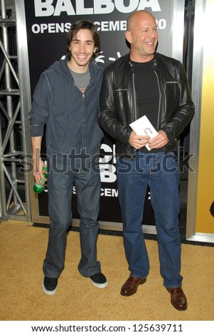 "HOLLYWOOD - DECEMBER 13: Justin Long and Bruce Willis at the world premiere of ""Rocky Balboa"" on December 13, 2006 at Grauman's Chinese Theatre, Hollywood, CA. - stock photo"