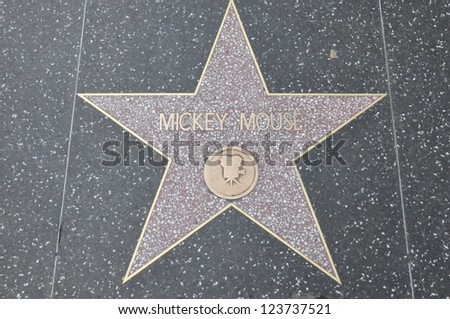 HOLLYWOOD - DECEMBER 7: Mickey Mouse's star on Hollywood Walk of Fame on December 7, 2012 in Hollywood, California. This star is located on Hollywood Blvd. and is one of 2400 celebrity stars. - stock photo