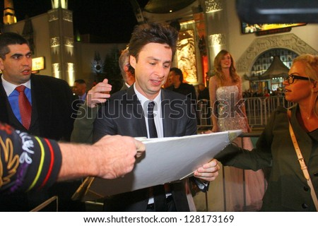 "HOLLYWOOD - FEBRUARY 13, 2013:Actor Zach Braff attends premiere of ""Oz: The Great and Powerful"" at the El Capitan Theatre February 13, 2013 Hollywood, CA. - stock photo"