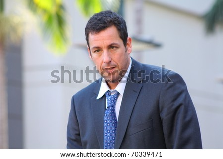 HOLLYWOOD - FEBRUARY 1: Comedian Adam Sandler on stage at his Walk of Fame ceremony on February 1, 2011 in Hollywood, CA 2011. - stock photo