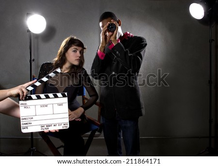 Hollywood film industry producers or directors in a sound stage - stock photo