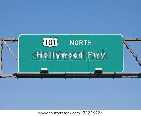 Hollywood 101 Freeway overhead sign with clear blue sky. - stock photo