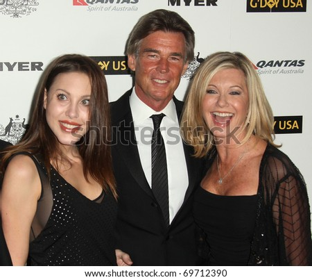 HOLLYWOOD - JAN 22:  Olivia Newton John, her husband & Chloe Lattanzi arrive at the 2011 G'Day USA Los Angeles Gala on January 22, 2011 in Hollywood, CA - stock photo