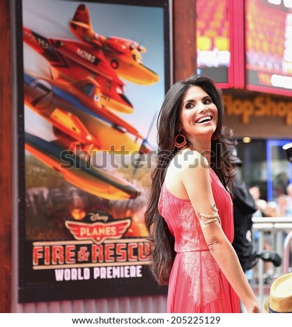 "HOLLYWOOD - JULY 15, 2014: Real Houswife of Beverly Hills and actor Joyce Giraud attend the premiere of ""Planes: Rescue & Fire"" at the El Capitan Theatre July 15, 2014 Hollywood, CA. - stock photo"
