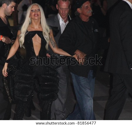 HOLLYWOOD - JULY 28: Singer Lady Gaga heading to the stage for a mini concert for Jimmy Kimmel Live! outside the Jimmy Kimmel Studio July 28, 2011 Hollywood, CA. - stock photo
