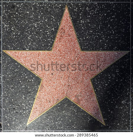 HOLLYWOOD - JUNE 24: empty star on Hollywood Walk of Fame on June 24, 2012 in Hollywood, California. This star is located on Hollywood Blvd. and is one of 2400 celebrity stars. - stock photo