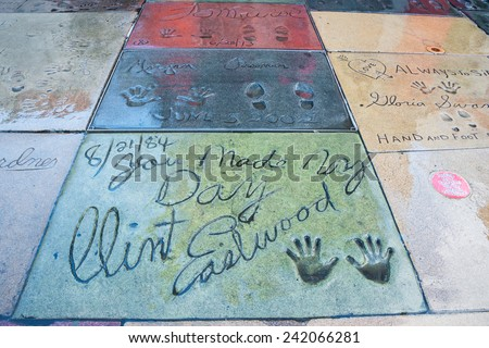 HOLLYWOOD, LOS ANGELES, CA -DEC 12: Movie stars handprints in TCL Chinese Theatre forecourt on Hollywood Boulevard Walk of Fame including Clint Eastwood, Morgan Freeman, and Tom Cruise, Dec 12, 2014. - stock photo