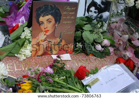 HOLLYWOOD - MARCH 23: Following news of Dame Elizabeth Taylor's death, fans create a memorial of flowers and notes for her on her star on the Hollywood Walk Of Fame on March 23, 2011 Hollywood, CA - stock photo