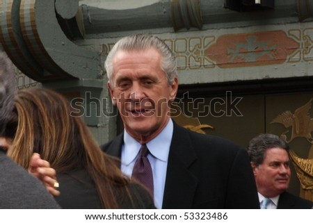 HOLLYWOOD - MAY 17:  Coach Pat Riley at ceremony where Jerry Bruckheimer was immortalized putting his hand/footprints in cement Grauman's Chinese Theatre May 17, 2010 Hollywood, California. - stock photo